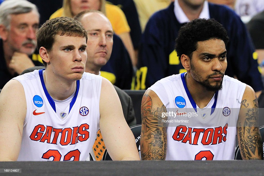 Erik Murphy #33 and Mike Rosario #3 of the Florida Gators look on dejected late in their 79 to 59 loss to the Michigan Wolverines during the South Regional Round Final of the 2013 NCAA Men's Basketball Tournament at Dallas Cowboys Stadium on March 31, 2013 in Arlington, Texas.