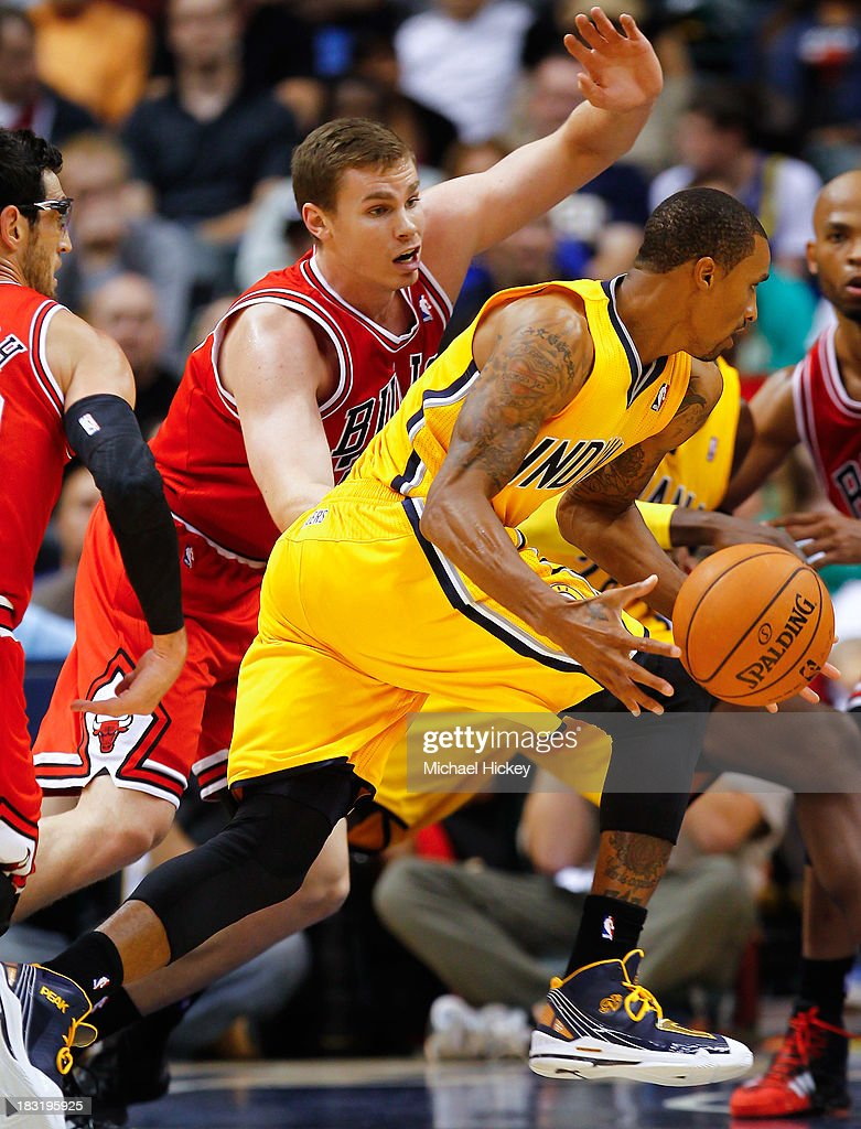 Erik Murphy #31 of the Chicago Bulls defends as George Hill #3 of the Indiana Pacers dribbles around him on October 5, 2013 at Bankers Life Fieldhouse in Indianapolis, Indiana. Chicago defeated Indiana 82-76.