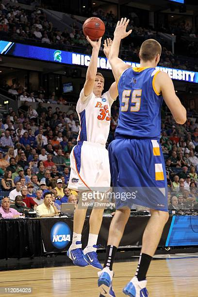 Erik Murphy of the Florida Gators attempts a shot against Greg Somogyi of the UC Santa Barbara Gauchos during the second round of the 2011 NCAA men's...