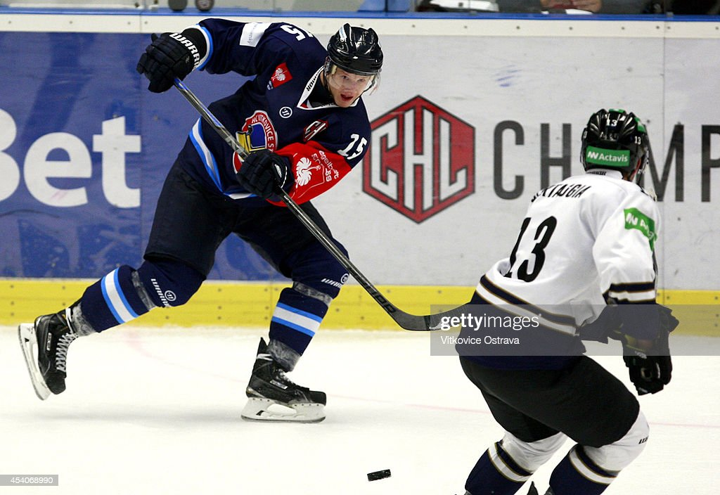 Erik Nemec of Vitkovice Ostrava offloads the puck during the Champions Hockey League group stage game between Vitkovice Ostrave and EV Zug on August 23, 2014 in Ostrava, Czech Republic.