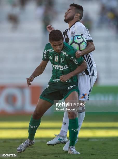 Erik of Palmeiras battles for the ball with Lins of Ponte Preta during the match between Ponte Preta and Palmeiras as a part of Campeonato Brasileiro...