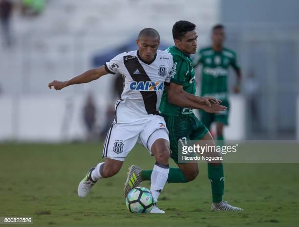 Erik of Palmeiras battles for the ball with Nino Paraiba of Ponte Preta during the match between Ponte Preta and Palmeiras as a part of Campeonato...