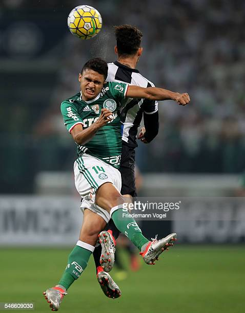 Erik of Palmeiras fights for the ball with Zeca of Santos during the match between Palmeiras and Santos for the Brazilian Series A 2016 at Allianz...