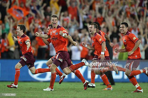 Erik Paartalu of the Roar celebrates victory with team mates after the ALeague Grand Final match between the Brisbane Roar and the Central Coast...