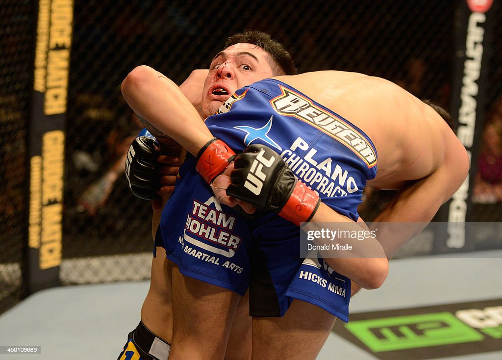 Erik Perez (pictured) carries Edwin Figueroa in their bantamweight bout during the UFC 167 event inside the MGM Grand Garden Arena on November 16, 2013 in Las Vegas, Nevada.