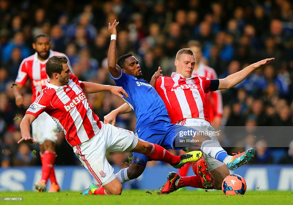 Erik Pieters and <a gi-track='captionPersonalityLinkClicked' href=/galleries/search?phrase=Ryan+Shawcross&family=editorial&specificpeople=4443278 ng-click='$event.stopPropagation()'>Ryan Shawcross</a> of Stoke City tackle <a gi-track='captionPersonalityLinkClicked' href=/galleries/search?phrase=Samuel+Eto%27o&family=editorial&specificpeople=210530 ng-click='$event.stopPropagation()'>Samuel Eto'o</a> of Chelsea during the FA Cup Fourth Round between Chelsea and Stoke City at Stamford Bridge on January 26, 2014 in London, England.