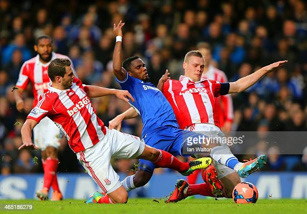 Erik Pieters and Ryan Shawcross of Stoke City tackle Samuel Eto'o of Chelsea during the FA Cup Fourth Round between Chelsea and Stoke City at...