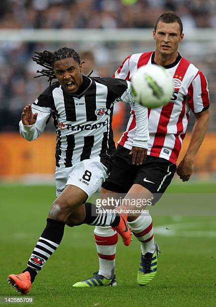 Erik Pieters of PSV and Lerin Duarte of Heracles battle for the ball during the Dutch Cup Final between PSV Eindhoven and SC Heracles Almelo at...