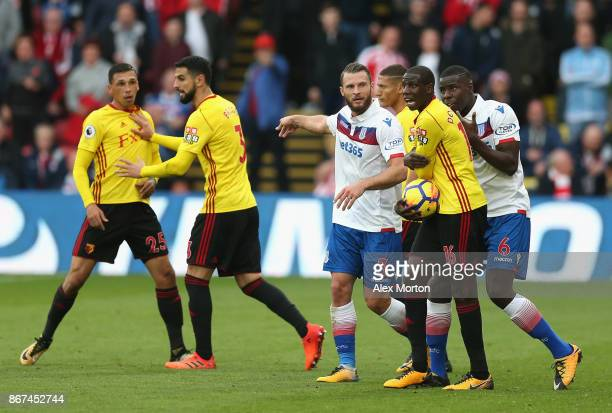 Erik Pieters of Stoke City and Abdoulaye Doucoure of Watford argue during the Premier League match between Watford and Stoke City at Vicarage Road on...