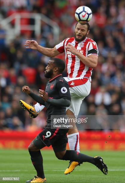 Erik Pieters of Stoke City and Alexandre Lacazette of Arsenal battle for possession during the Premier League match between Stoke City and Arsenal at...