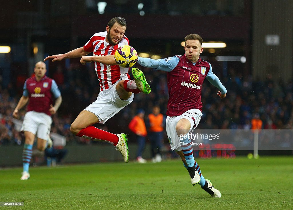 Erik Pieters of Stoke City and Andreas Weimann of Aston Villa battle for the ball during the Barclays Premier League match between Aston Villa and Stoke City at Villa Park on February 21, 2015 in Birmingham, England.
