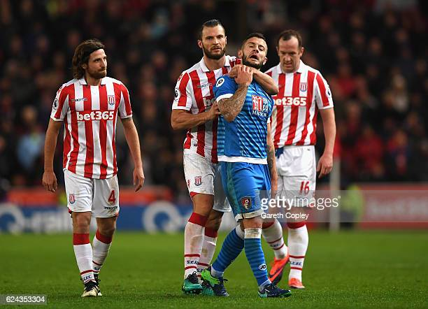 Erik Pieters of Stoke City and Jack Wilshere of AFC Bournemouth exchange words during the Premier League match between Stoke City and AFC Bournemouth...