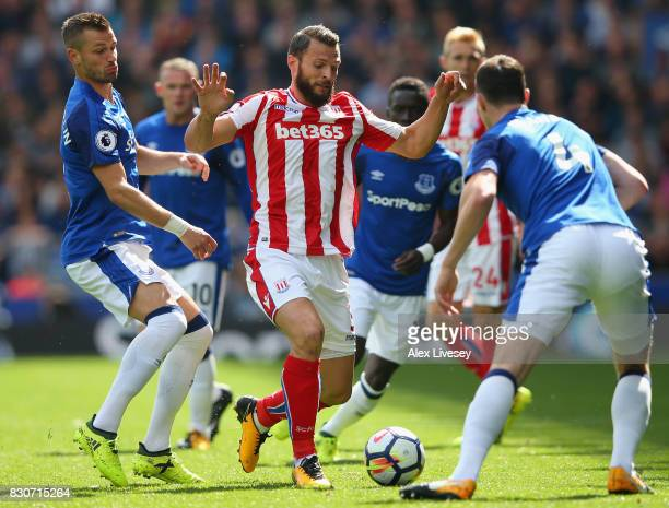 Erik Pieters of Stoke City and Morgan Schneiderlin of Everton battle for possession during the Premier League match between Everton and Stoke City at...