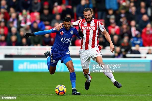 Erik Pieters of Stoke City and Riyad Mahrez of Leicester City battle for the ball during the Premier League match between Stoke City and Leicester...