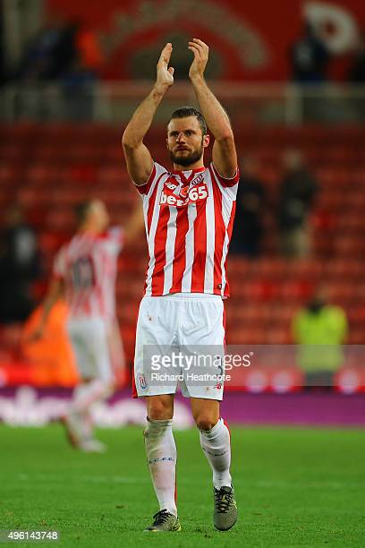 Erik Pieters of Stoke City applauds supporters after his team's 10 win in the Barclays Premier League match between Stoke City and Chelsea at...