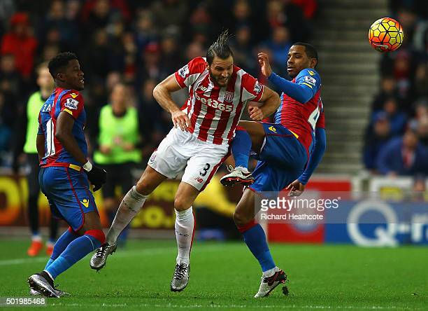 Erik Pieters of Stoke City competes for the ball against Wilfried Zaha and Jason Puncheon of Crystal Palace during the Barclays Premier League match...