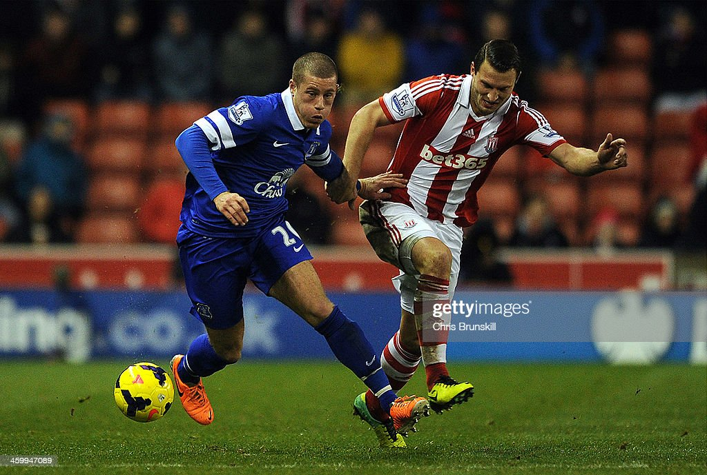 Erik Pieters of Stoke City in action with <a gi-track='captionPersonalityLinkClicked' href=/galleries/search?phrase=Ross+Barkley&family=editorial&specificpeople=5806369 ng-click='$event.stopPropagation()'>Ross Barkley</a> of Everton during the Barclays Premier League match between Stoke City and Everton at Britannia Stadium on January 01, 2014 in Stoke on Trent, England.