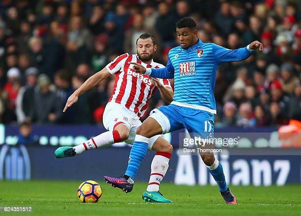 Erik Pieters of Stoke City puts pressure on Joshua King of AFC Bournemouth during the Premier League match between Stoke City and AFC Bournemouth at...