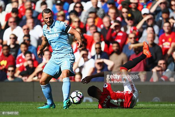 Erik Pieters of Stoke City tackles Jesse Lingard of Manchester United during the Premier League match between Manchester United and Stoke City at Old...