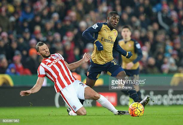 Erik Pieters of Stoke City tackles Joel Campbell of Arsenal during the Barclays Premier League match between Stoke City and Arsenal at Britannia...