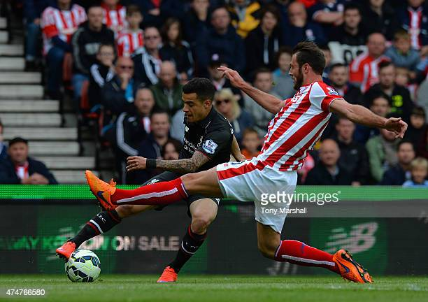 Erik Pieters of Stoke City tackles Philippe Coutinho of Liverpool during the Barclays Premier League match between Stoke City and Liverpool at...