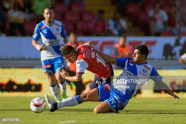 Erik Pimentel of Puebla and Daniel Villalva of Veracruz fight for the ball during the 3rd round match between Veracruz and Puebla as part of the...