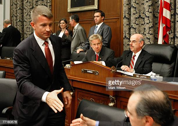 Erik Prince chairman of the Prince Group LLC and Blackwater USA shakes hands with committee members as Rep Henry Waxman and Rep Tom Davis sit nearby...