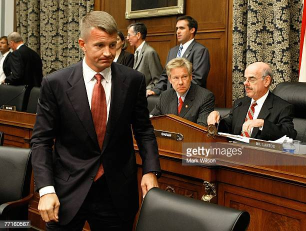 Erik Prince chairman of the Prince Group LLC and Blackwater USA walks away after shaking hands with Rep Henry Waxman and Rep Tom Davis after...