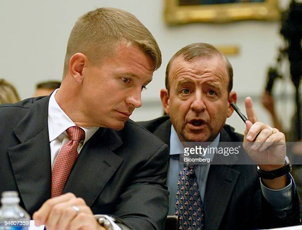 Erik Prince left chairman of Blackwater USA confers with attorney Stephen Ryan during a House Oversight and Government Reform Committee hearing in...