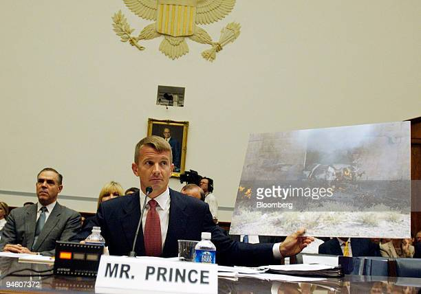 Erik Prince the chairman of Blackwater USA displays a picture of a Blackwater vehicle hit by a suicide car bomb in Mosul Iraq in 2005 as he testifies...