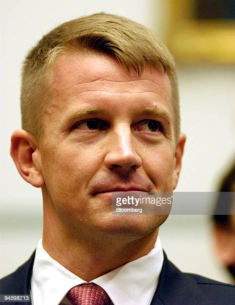 Erik Prince the chairman of Blackwater USA waits to testify at a House Oversight and Government Reform Committee hearing in Washington DC US on...