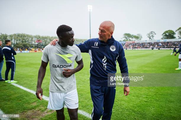Erik Rasmussen head coach of Vendsyssel FF speaks to Moses Opondo of Vendsyssel FF prior to the Danish Alka Superliga Playoff match between...