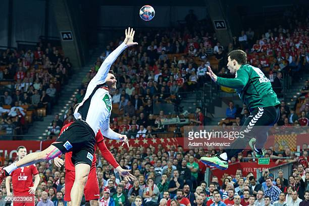 Erik Schmidt from Germany throws the ball against goalkeeper Victor Kireev from Russia during the Men's EHF Handball European Championship 2016 match...