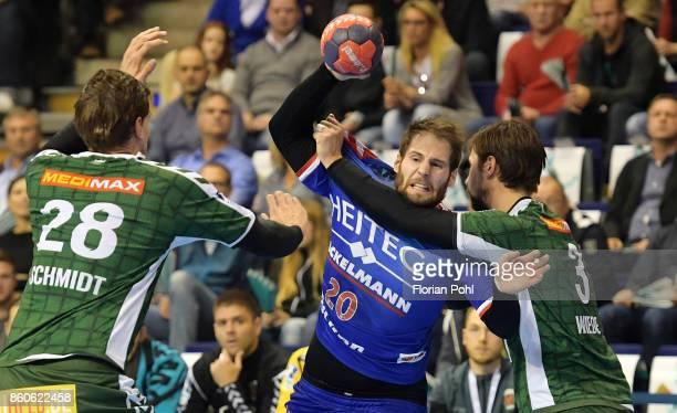 Erik Schmidt of Fuechse Berlin Nico Buedel of HC Erlangen and Fabian Wiede of Fuechse Berlin during the game between Fuechse Berlin and the HC...