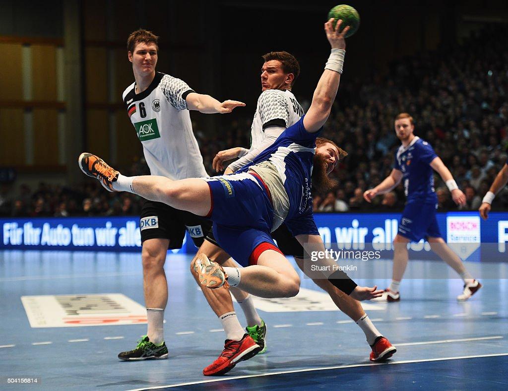 Erik Schmidt of Germany challenges Kari Kristjan Kristjansson of Iceland during the international handball friendly match between Germany and Iceland on January 9, 2016 in Kassel, Germany.