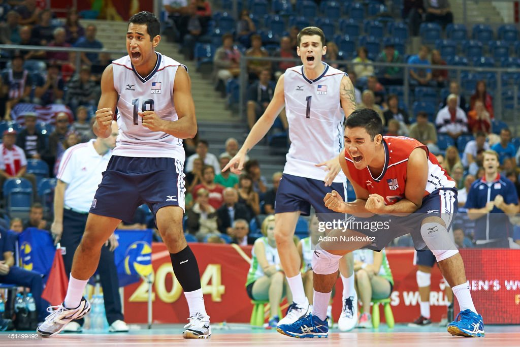 Erik Shoji of USA (right) and Garrett Muagututia of USA (left) celebrate winning the point during the FIVB World Championships match between USA and Iran at Cracow Arena on September 2, 2014 in Cracow, Poland.