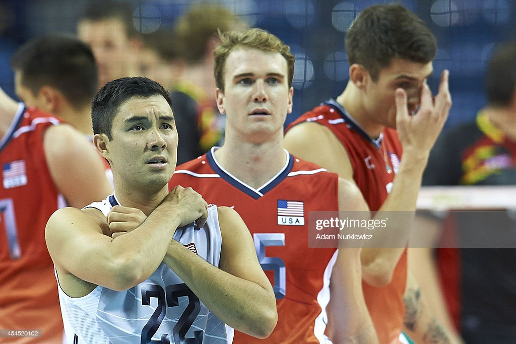 Erik Shoji of USA (left) reacts after loose point during the FIVB World Championships Volleyball at Cracow Arena on August 31, 2014 in Cracow, Poland.