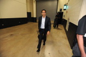 Erik Spoelstra head coach of the Miami Heat arrives before the game against the San Antonio Spurs during Game Five of the 2014 NBA Finals at ATT...