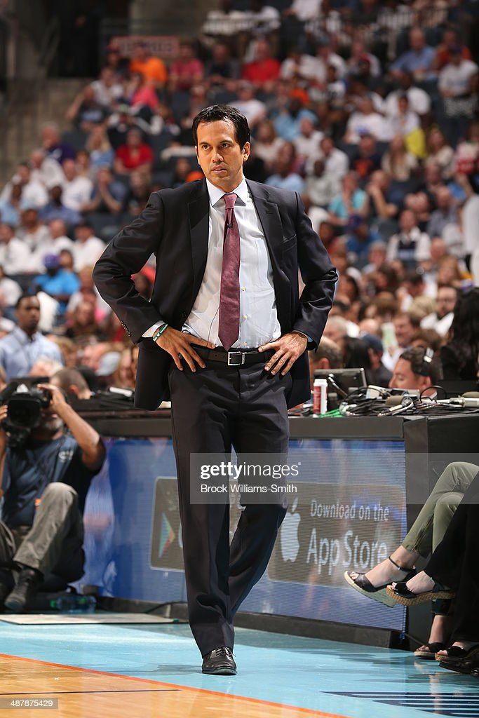 Erik Spoelstra head coach of the Miami Heat stand on the court during a game against the Charlotte Bobcats in Game One of the Eastern Conference Quarterfinals of the 2014 NBA playoffs at the Time Warner Cable Arena on April 28, 2014 in Charlotte, North Carolina.