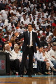 Erik Spoelstra Head Coach of the Miami Heat stands on the sideline during a game against the Charlotte Bobcats during Game Three of the Eastern...