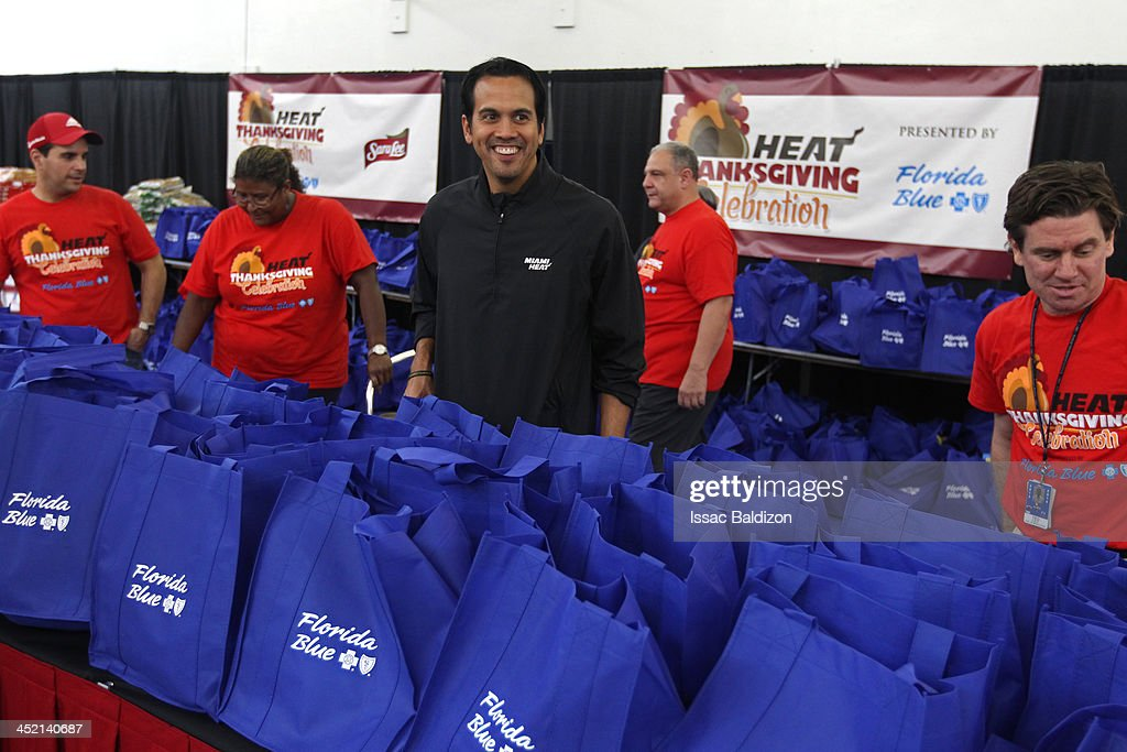 Erik Spoelstra of the Miami Heat celebrates the annual Heat Thanksgiving Celebration on November 22 2013 at the Miami Rescue Mission in Miami Florida...