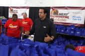 Erik Spoelstra of the Miami Heat celebrates the annual Heat Thanksgiving Celebration on November 22 2013 at the Miami Rescue Mission in Miami Florida...