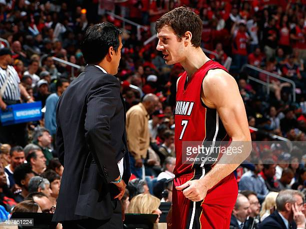 Erik Spoelstra of the Miami Heat converses with Goran Dragic during the game against the Atlanta Hawks at Philips Arena on March 27 2015 in Atlanta...