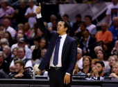 Erik Spoelstra of the Miami Heat motions to his players against the San Antonio Spurs during Game Five of the 2014 NBA Finals at the ATT Center on...