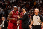 Erik Spoelstra of the Miami Heat shares a word with LeBron James during the game the game against the Indiana Pacers on December 18 2013 at American...