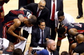 Erik Spoelstra of the Miami Heat speaks to his team in a huddle against the Indiana Pacers during Game Five of the Eastern Conference Finals of the...