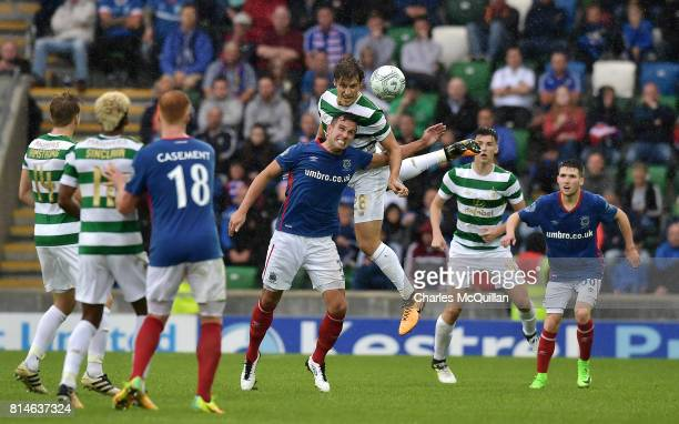 Erik Sviatchenko of Celtic and Andrew Waterworth of Linfield contest a high ball during the Champions League second round first leg qualifying game...