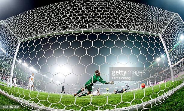 Erik Sviatchenko scores the 22 goal against Goalkeeper Peter Friis of Viborg FF during of Midtjylland the Danish Alka Superliga match between FC...