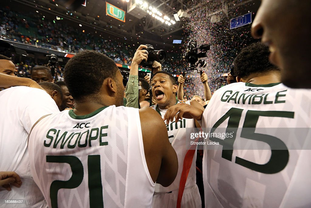 Erik Swoope #21, Kenny Kadji #35 and Julian Gamble #45 of the Miami (Fl) Hurricanes celebrate after they won 87-77 against the North Carolina Tar Heels during the final of the Men's ACC Basketball Tournament at Greensboro Coliseum on March 17, 2013 in Greensboro, North Carolina.
