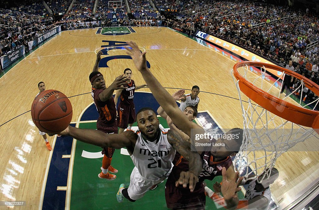 Erik Swoope of the Miami Hurricanes drives to the basket against Trevor Thompson of the Virginia Tech Hokies during the first round of the 2014 Men's...
